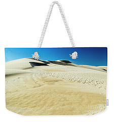 Weekender Tote Bag featuring the photograph Drifting Away by Angela DeFrias