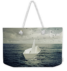 Weekender Tote Bag featuring the photograph Drifting Paper Boat by Carlos Caetano