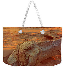 Weekender Tote Bag featuring the photograph Driftwood At Sunset by Michelle Calkins