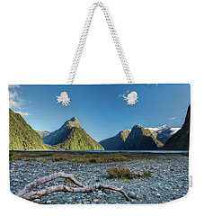 Weekender Tote Bag featuring the photograph Driftwood In Milford Sound by Gary Eason
