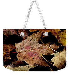 Weekender Tote Bag featuring the photograph Droplets On Fallen Leaves by Doris Potter