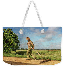 Weekender Tote Bag featuring the photograph Drying Rice by Lou Novick