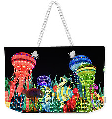 Weekender Tote Bag featuring the photograph Dubai - Garden Glow by Hanza Turgul