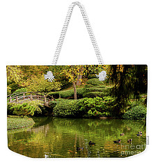 Weekender Tote Bag featuring the photograph Ducks In Summertime by Iris Greenwell