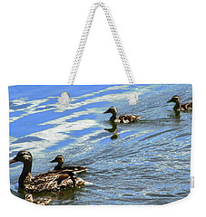 Weekender Tote Bag featuring the photograph Ducks by Stephanie Moore