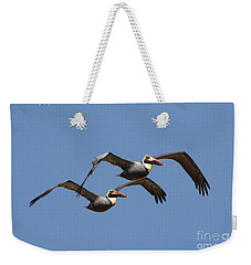 Duel Pelicans In Flight Weekender Tote Bag