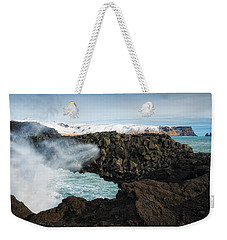 Weekender Tote Bag featuring the photograph Dyrholaey Rock Arch Iceland by Matthias Hauser