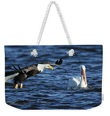 Weekender Tote Bag featuring the photograph Eagle And Pelican by Coby Cooper