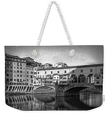 Weekender Tote Bag featuring the photograph Early Morning Ponte Vecchio Florence Italy by Joan Carroll