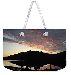 Weekender Tote Bag featuring the photograph Early Morning Red Sky by Barbara Griffin