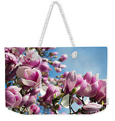 Weekender Tote Bag featuring the photograph Early Spring Magnolia by Angela DeFrias
