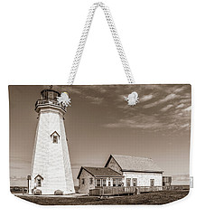 Weekender Tote Bag featuring the photograph East Point Lighthouse by Chris Bordeleau