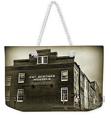 Weekender Tote Bag featuring the photograph Eat Berthas Mussels In Black And White by Paul Ward