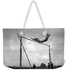 Weekender Tote Bag featuring the painting Ed Cook In The Pole Vault by Artistic Panda