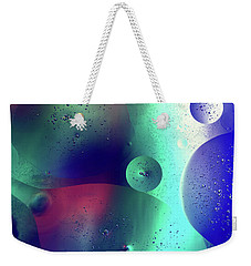 Weekender Tote Bag featuring the photograph Electric Oil Droplets Number One by John Williams