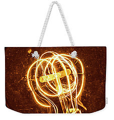 Weekender Tote Bag featuring the photograph Electricity Through Tungsten by T Brian Jones