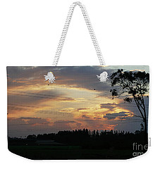 Weekender Tote Bag featuring the photograph Electrified Sunset by Arik Baltinester