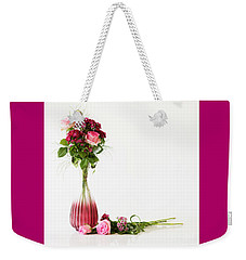 Weekender Tote Bag featuring the photograph Elegance by Wendy Wilton