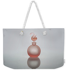 Weekender Tote Bag featuring the photograph Elegant Frosted Pink Vintage Perfume Bottle by David and Carol Kelly