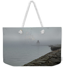 Weekender Tote Bag featuring the photograph Emerging From The Fog by Jeff Folger