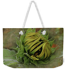 Weekender Tote Bag featuring the photograph Emerging Sunflower by Judy Hall-Folde