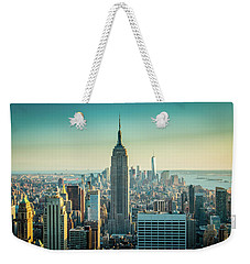 Weekender Tote Bag featuring the photograph Empire Skies by Sara Frank