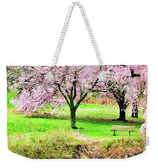 Weekender Tote Bag featuring the photograph Empty Bench Surrounded By Spring Colors by Gary Slawsky
