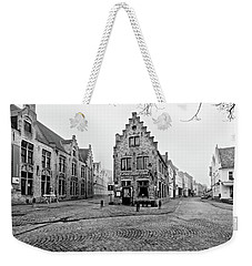 Weekender Tote Bag featuring the photograph Empty Streets In Bruges On A Misty Morning by Barry O Carroll