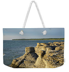 Weekender Tote Bag featuring the photograph Eroded Cliff Formations by Kennerth and Birgitta Kullman
