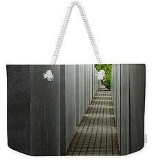 Weekender Tote Bag featuring the photograph Escape From Oppression by Geoff Smith