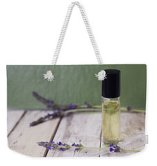 Weekender Tote Bag featuring the photograph Essential Oil And Lavender by Cindy Garber Iverson