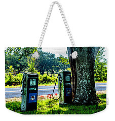 Weekender Tote Bag featuring the photograph Esso by Ken Frischkorn