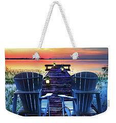 Weekender Tote Bag featuring the photograph Evening Romance by Debra and Dave Vanderlaan