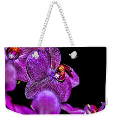 Weekender Tote Bag featuring the photograph Exotic by Diana Mary Sharpton