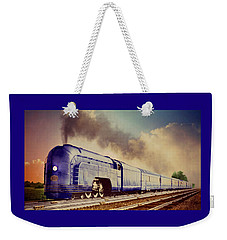 Weekender Tote Bag featuring the photograph Express by Steven Agius