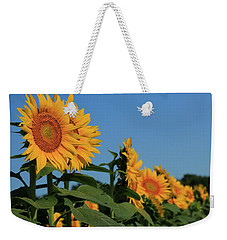 Weekender Tote Bag featuring the photograph Facing East by Chris Berry