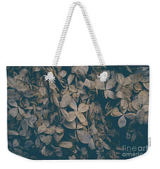 Weekender Tote Bag featuring the photograph Faded Flowers by Edward Fielding