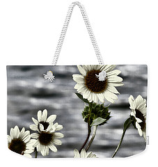 Weekender Tote Bag featuring the photograph Fading Sunflowers by Susan Kinney