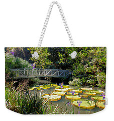 Weekender Tote Bag featuring the mixed media Fairies On The Lily Pods by Rosalie Scanlon