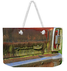 Weekender Tote Bag featuring the photograph Fairlane Emblem by Doug Camara