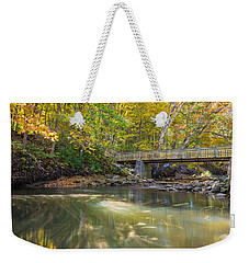Weekender Tote Bag featuring the photograph Fall In Motion by Steven Santamour
