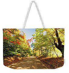 Weekender Tote Bag featuring the photograph Fall Roads by Lars Lentz