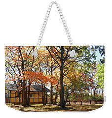 Weekender Tote Bag featuring the photograph Fall Shadows In The Park by Irina Sztukowski