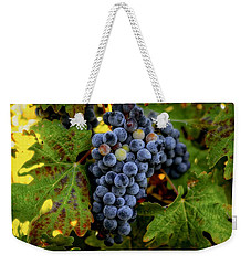 Weekender Tote Bag featuring the photograph Fall Wine Grapes by Lynn Hopwood