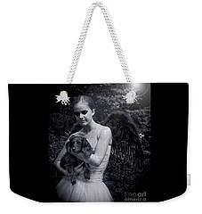 Weekender Tote Bag featuring the photograph Fallen Angel by Rebecca Margraf