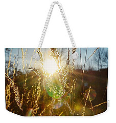Weekender Tote Bag featuring the photograph Fallen Rays by Nikki McInnes