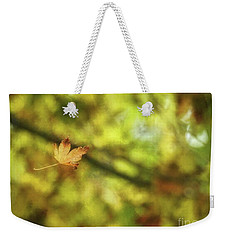 Weekender Tote Bag featuring the photograph Falling by Peggy Hughes