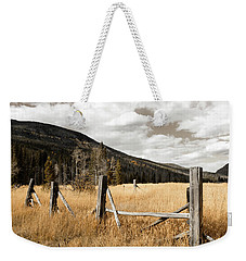 Weekender Tote Bag featuring the photograph Fallowfield Weathered Fence Rocky Mountain National Park Dramatic Sky by John Stephens