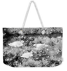 Weekender Tote Bag featuring the photograph Family by Desline Vitto
