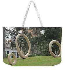 Weekender Tote Bag featuring the photograph Family Of O's by Aaron Martens